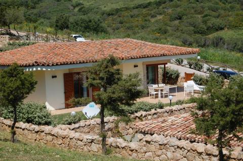 Vrijstaande huisjes met terras en uitzicht.